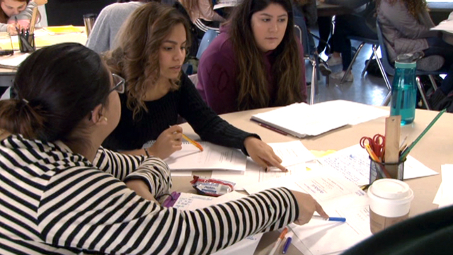Students discussing mathematics problem